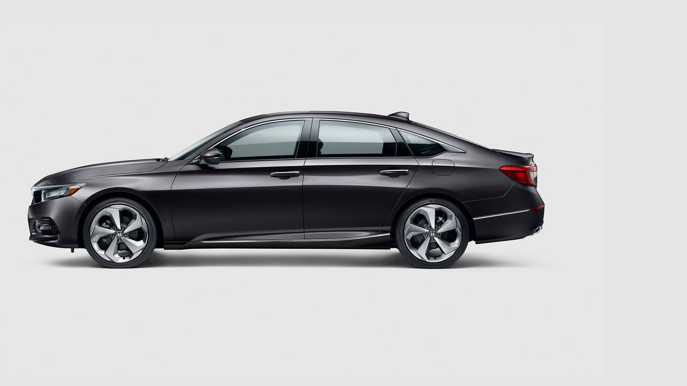 Driver-side profile view of the 2020 Honda Accord Touring 2.0T in Modern Steel Metallic.