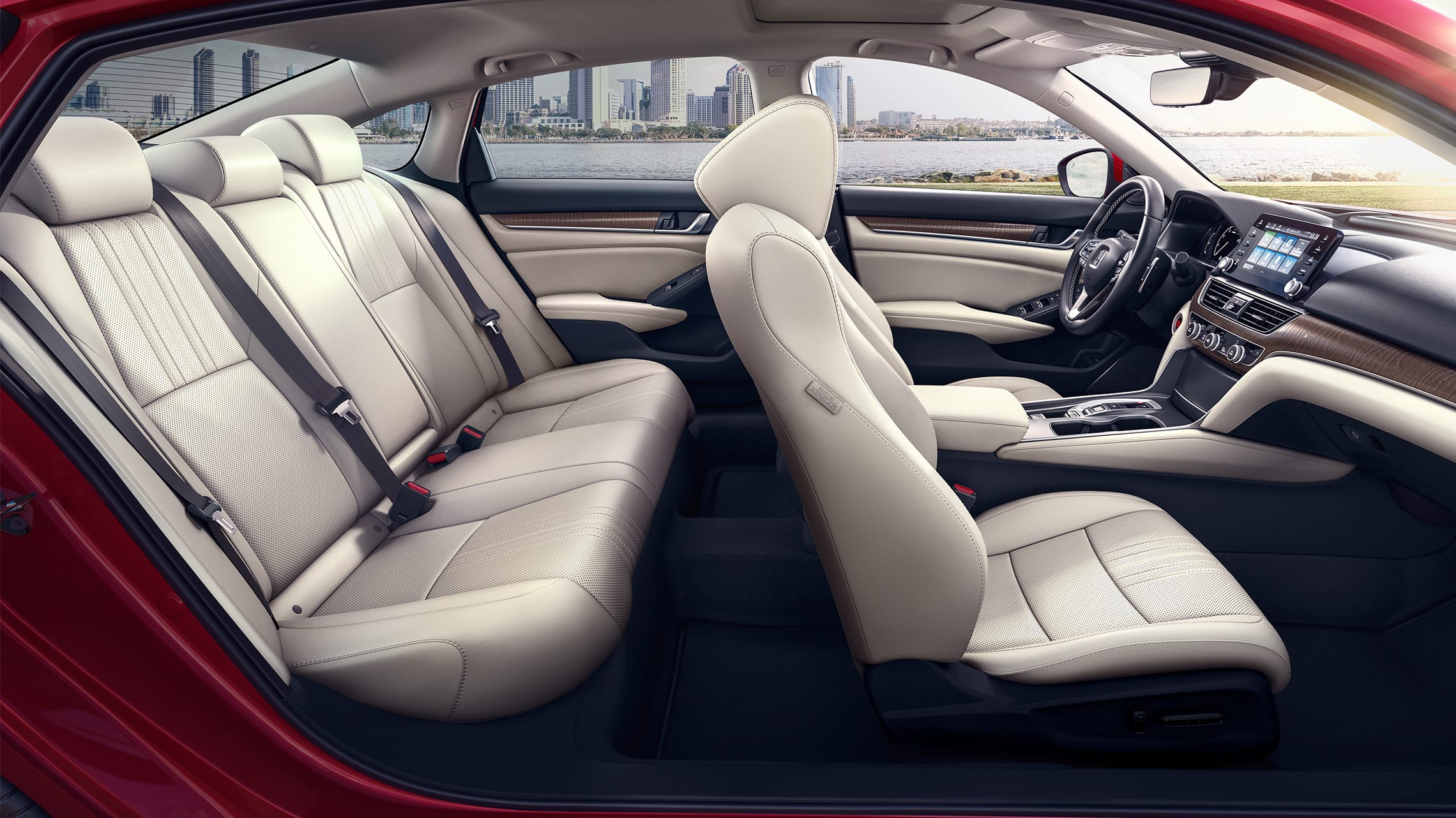 Passenger-side view of interior seats in the 2020 Honda Accord Touring 2.0T in Radiant Red Metallic with Ivory Leather.