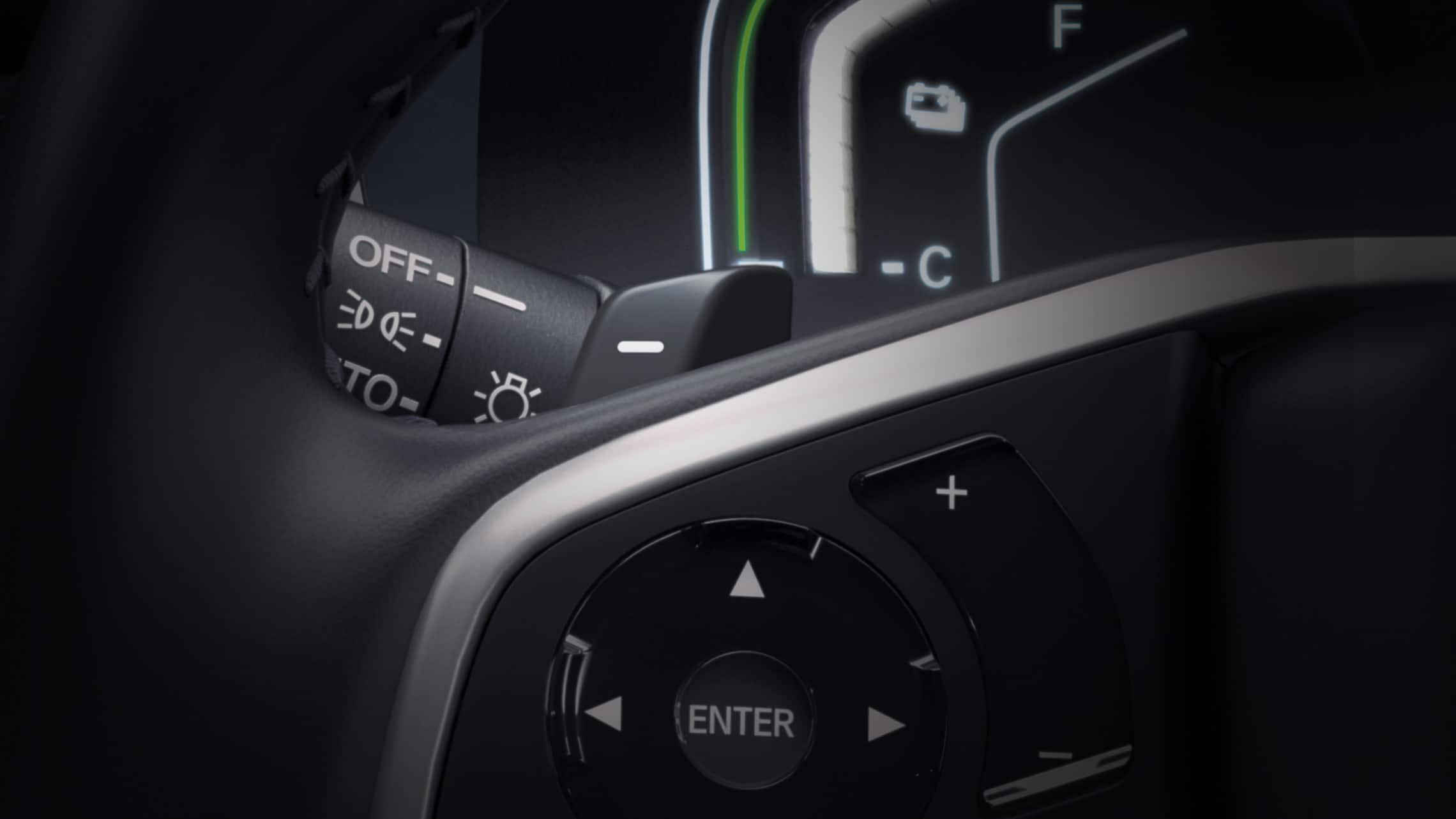 Detail view of the 2020 CR-V Hybrid Touring steering wheel with deceleration selectors.