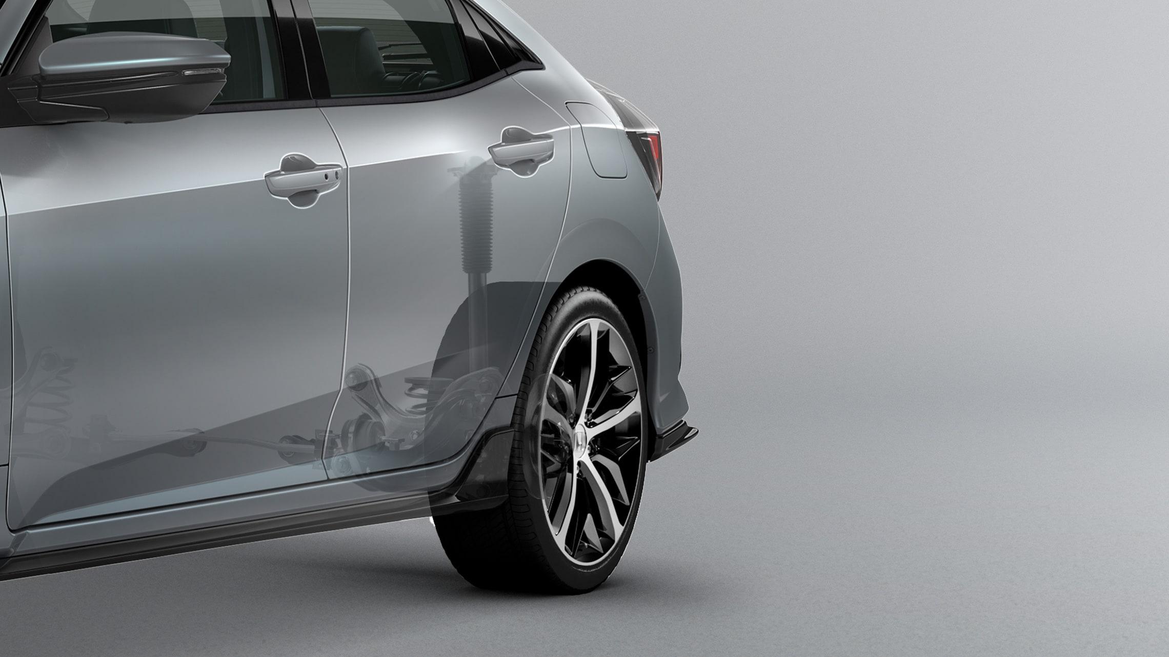 Ilustración seleccionada de la suspensión trasera independiente en el Honda Civic Sport Touring Hatchback2020 en Sonic Gray Pearl.