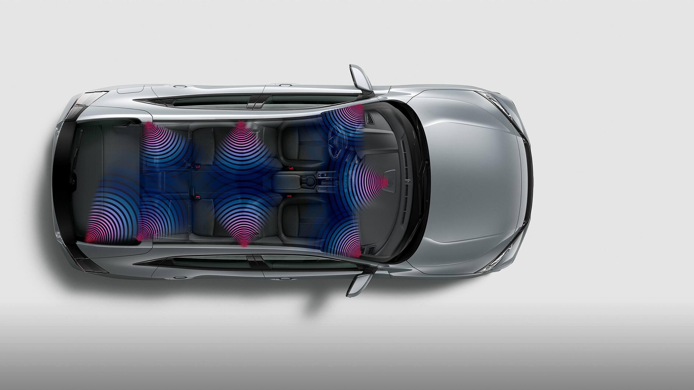 Vista interior aérea del Honda Civic Sport Touring Hatchback2020 en Sonic Gray Pearl con diagrama ilustrado del sistema de audio con 12altavoces.