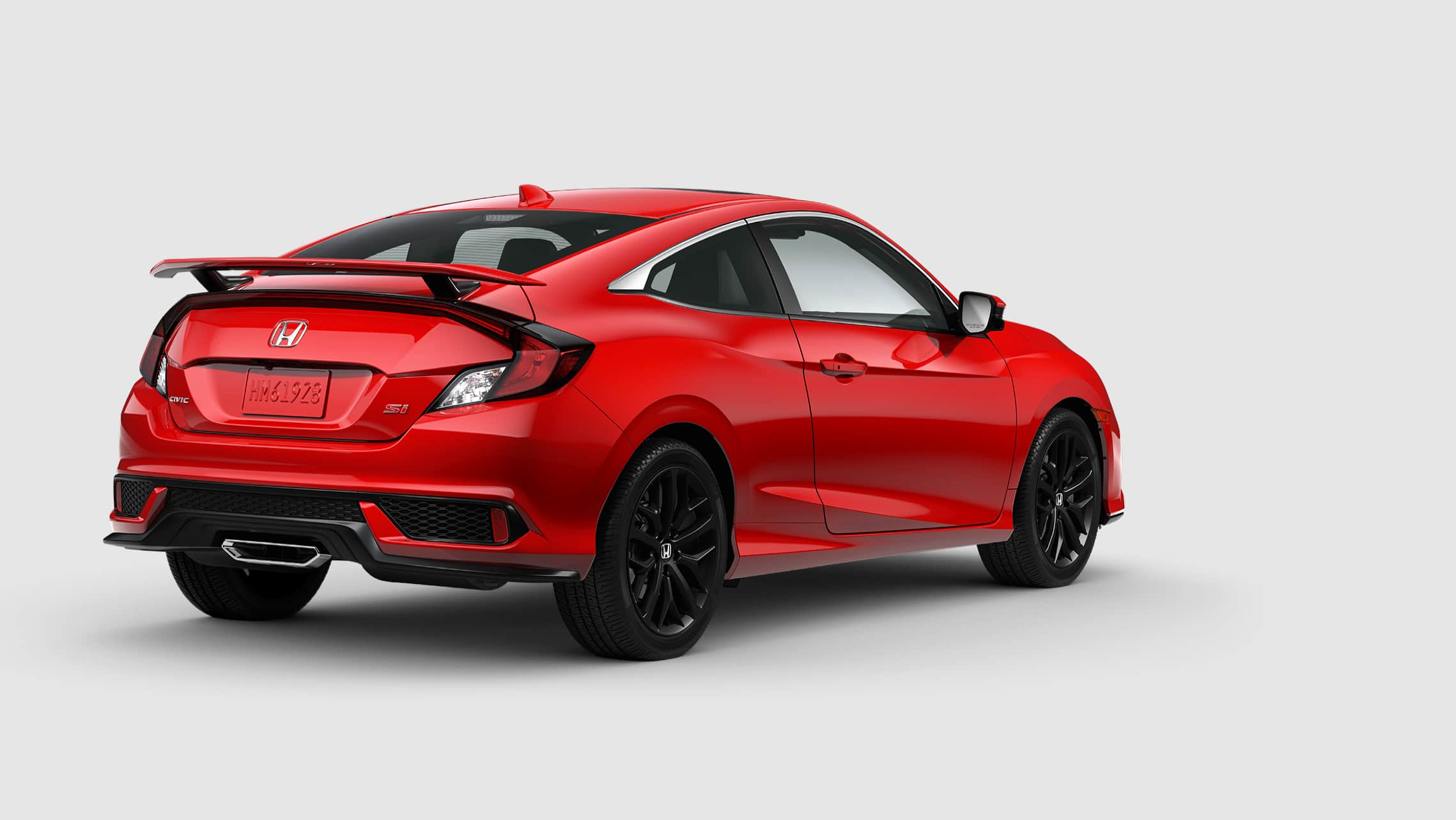 Vista trasera del Honda Civic Si Coupé 2020 en Rallye Red.
