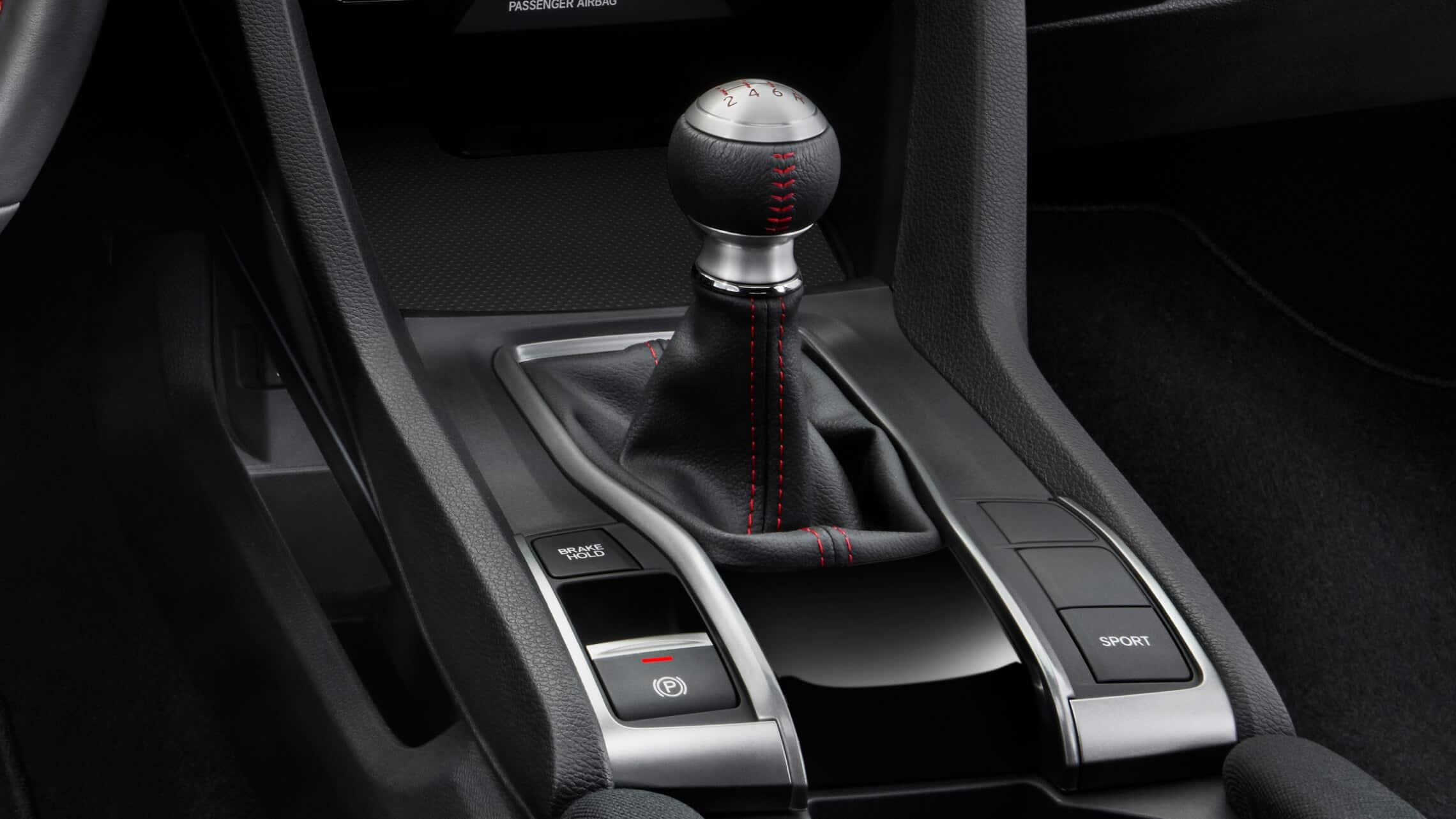 Detalle del mando de transmisión manual de 6velocidades con controles de modo de conducción en el Honda Civic Si Sedán2020.