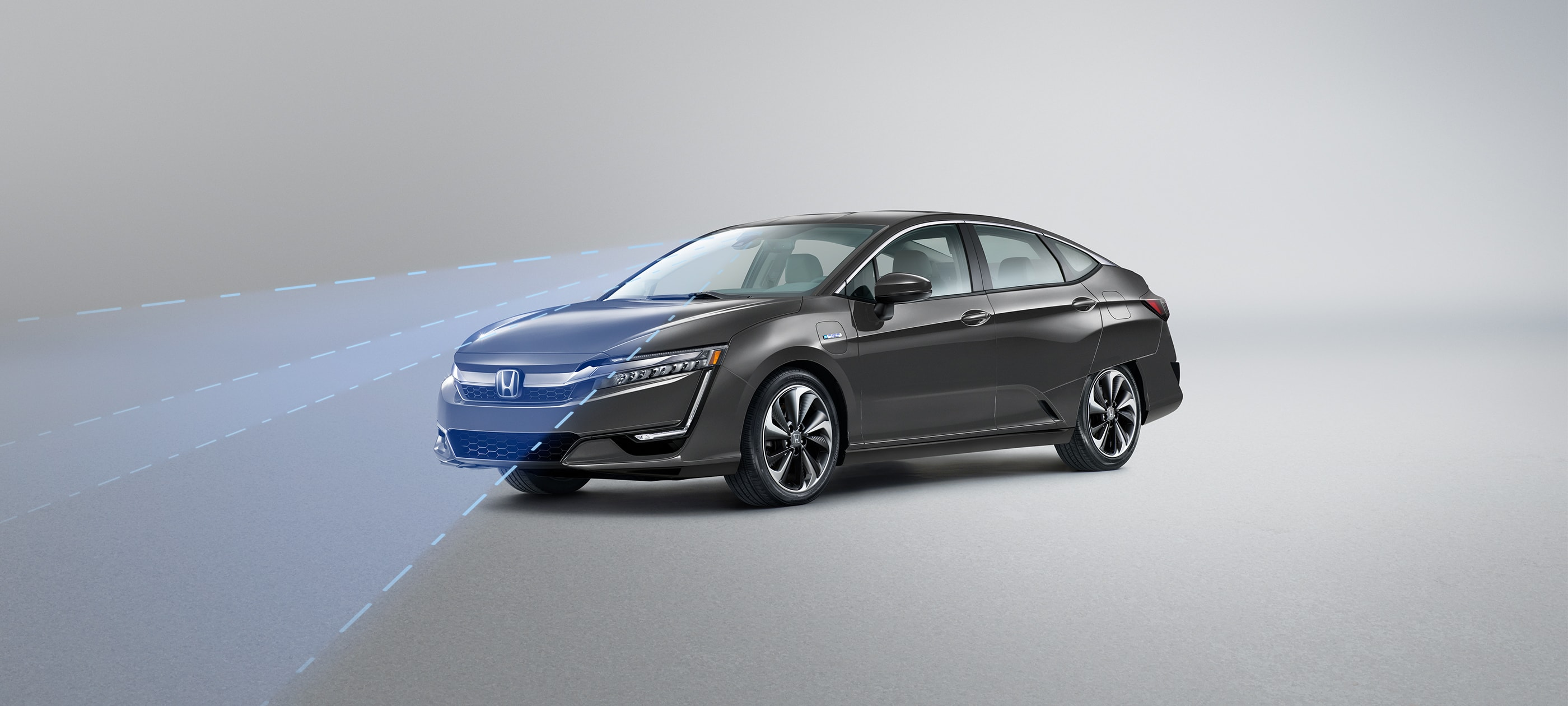 Front ¾ driver-side view of 2020 Honda Clarity Plug-In Hybrid in Modern Steel Metallic with Honda Sensing® illustrated demonstration.