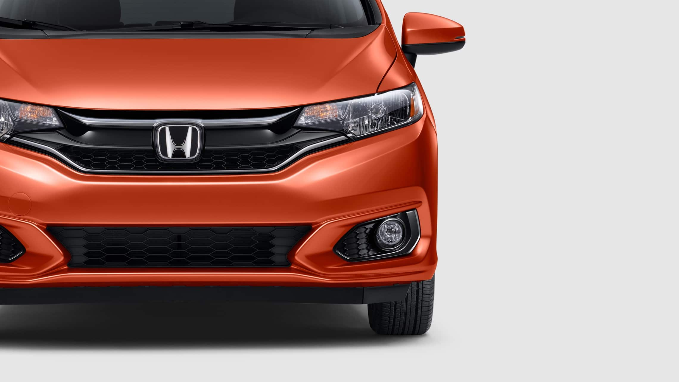 Front exterior view of the 2020 Honda Fit EX-L in Orange Fury.