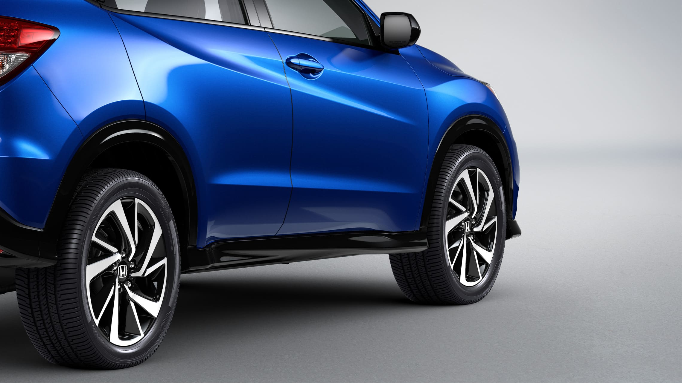 Rear 3/4 passenger-side view of sill detail on the 2020 Honda HR-V Sport in Aegean Blue Metallic.