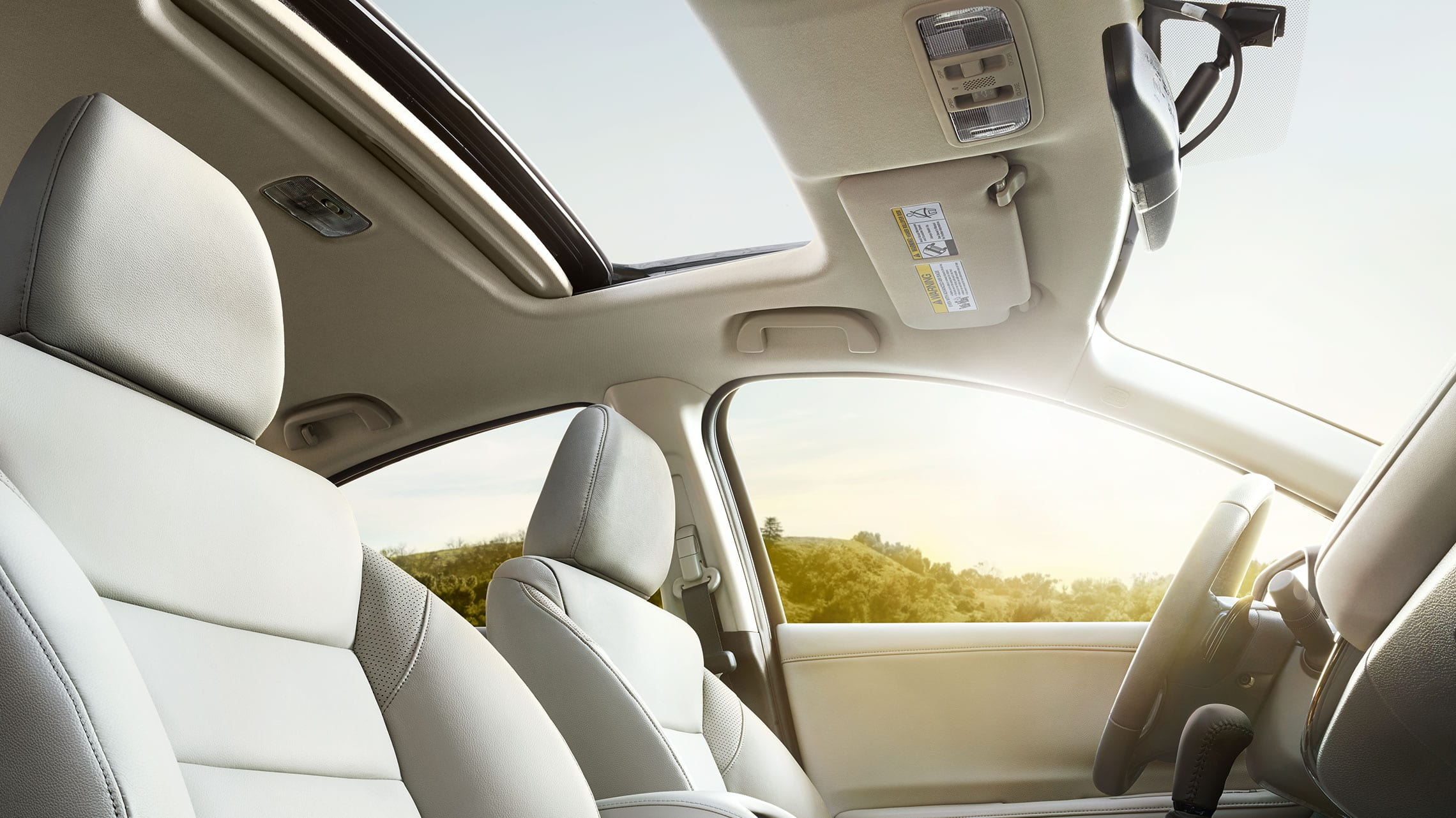 Passenger-side view of open moonroof detail on the 2020 Honda HR-V EX-L with Gray Leather.