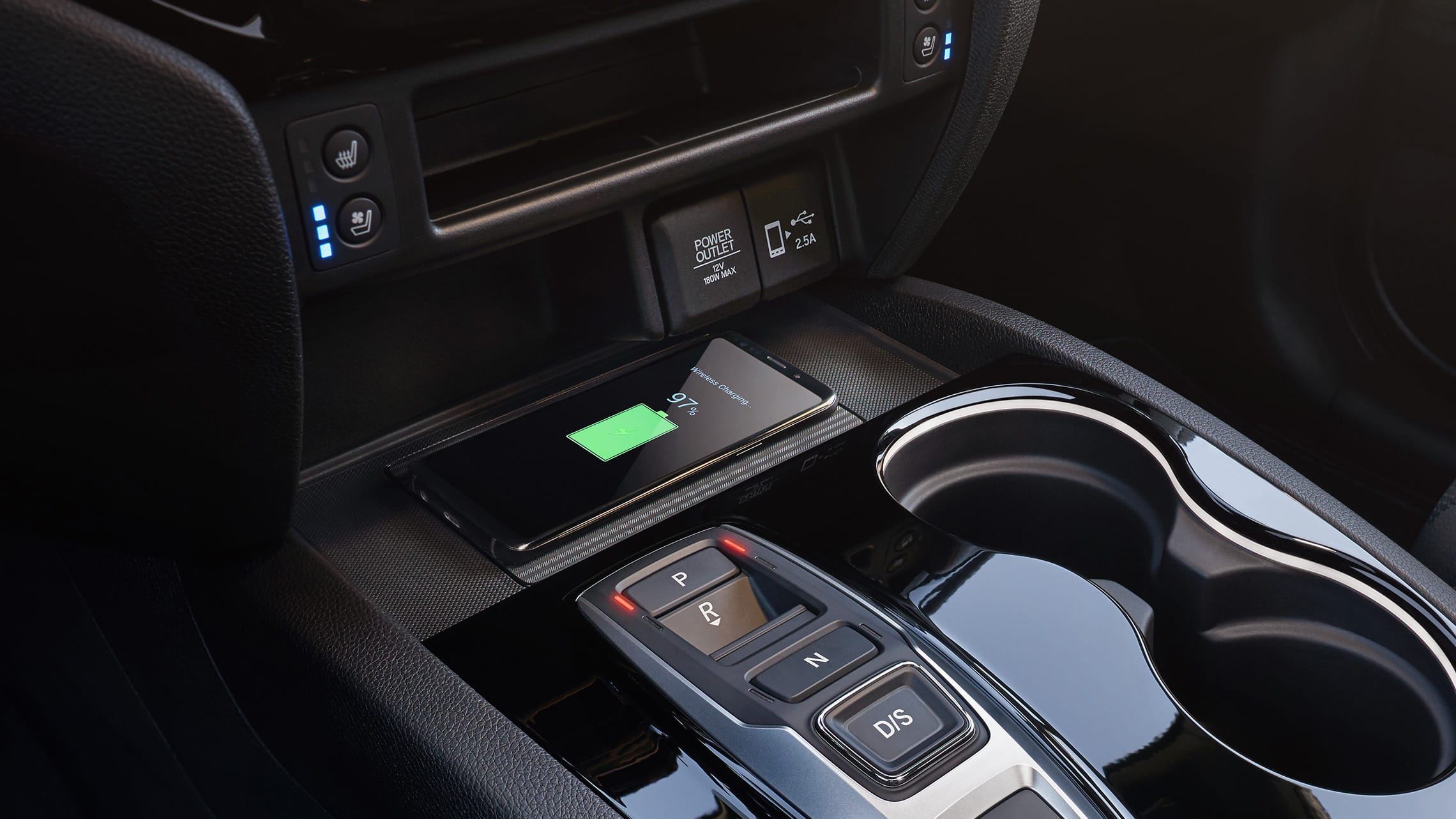 Wireless phone charger detail on the 2020 Honda Passport Elite.