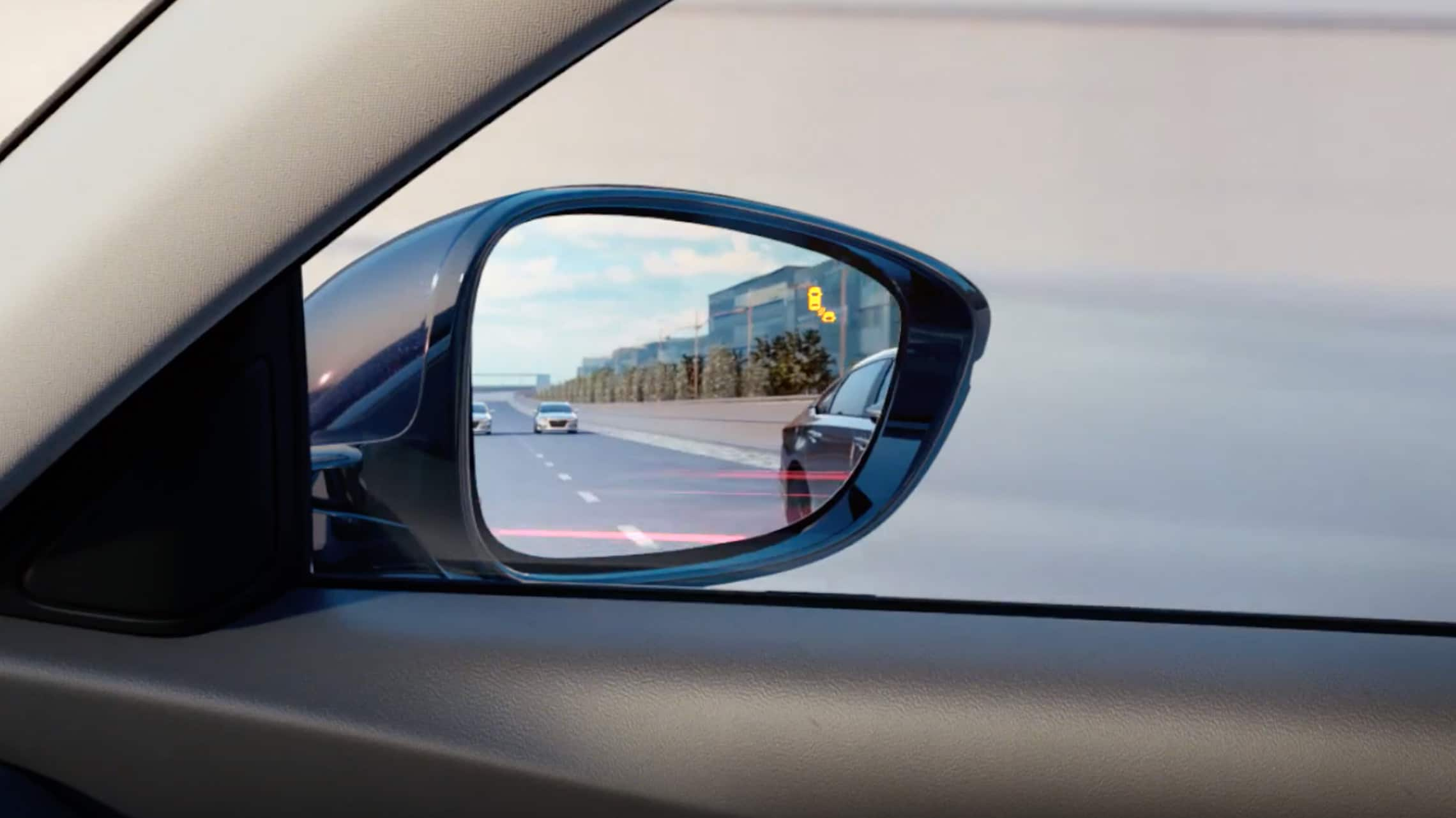 Detail of blind spot information system indicator on passenger-side mirror in the 2020 Honda Accord.